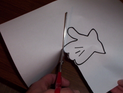 [A lefty cutting with right-handed scissors - note the poor result.]